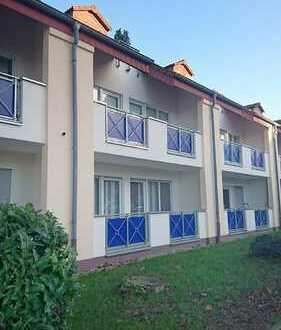 Hübsche Erdgeschoss-Wohnung mit Balkon und Tiefgaragenstellplatz