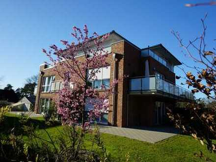 Exclusive Erdgeschosswohnung im KFW-55 Haus in bester Lage!