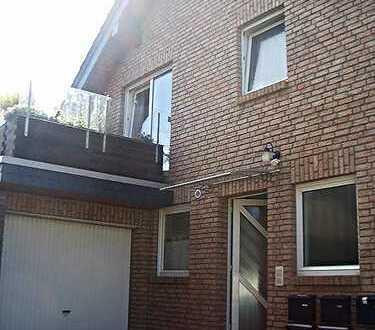 Moderne, komfortable Maisonette-Wohnung mit Dachterrasse, Garten und Garage