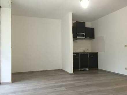 Vermietet wird eine 1 Zimmer Wohnung mit einem großen überdachten Balkon sowie Einbauküche