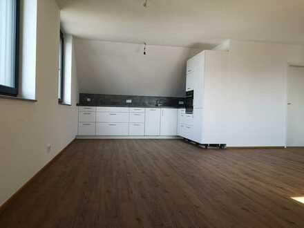 Erstbezug: Schöne 4-Zimmer-Dachgeschosswohnung mit Einbauküche in Wallenhausen