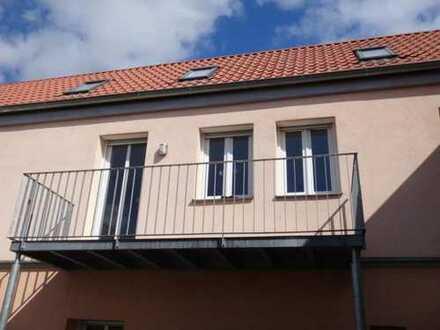 Moderne Maisonette- Wohnung mit Balkon  und zwei KFZ- Stellplätzen