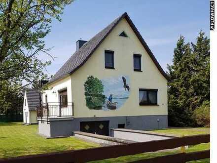 Haus mit 2 Wohneinheiten und Nebengebäude