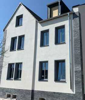 Aussergewöhnliche, kernsanierte 4 Zimmer Erdgeschosswohnung mit Terrasse