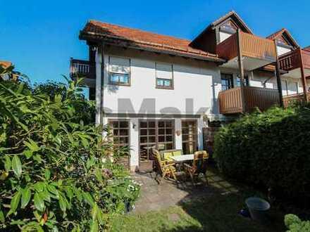 Familiendomizil in Ortsrandlage: Gepflegtes REH mit Garten, Balkon und Tiefgarage in Germering