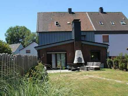 ETW in gepflegtem Zweifamilienwohnhaus mit Garten und Garage