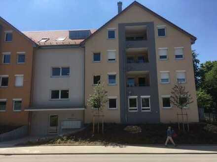 Erstbezug in zentraler Lage! 2 Zimmer mit offenem Wohn-/Essbereich und Wintergarten