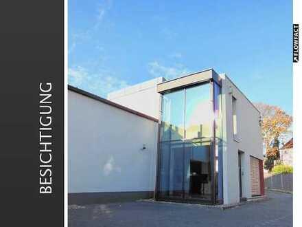 Repräsentatives Bürogebäude mit Lagerhalle und guter Verkehrsanbindung