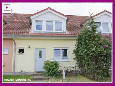 FRANK IMMOBILIEN - Wohnen in netter Nachbarschaft! RMH mit kleinem Gartenglück!