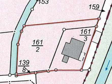Buschkämpen: 1250 m² Baugrundstück mit Abrisshaus