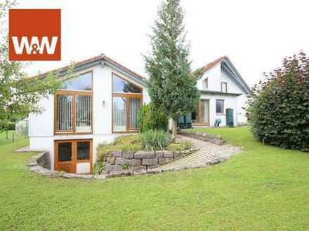 Attraktives EFH mit Anbau, Fitnessraum, Doppelgarage und wunderschönem Garten!
