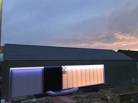 Wohnen im Architektenhaus: stilvolle 1-Zimmer-Wohnung mit Terrasse in Ebersbach