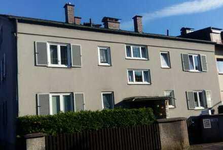 2-Zi-Wohnung (Erdgeschoss) mit Südterrasse, Einbauküche und Gartenbenützung