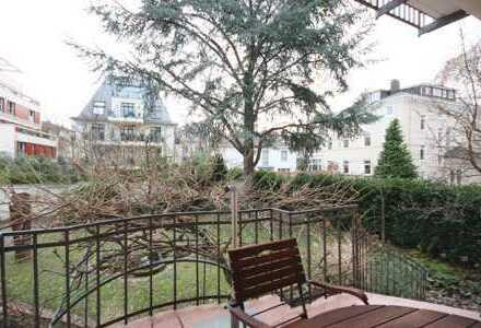 Traumhafte Altbau Einheit mit Balkon und großem Südgarten in bester Westend Lage