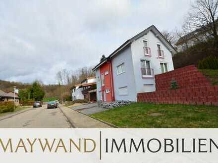 Freistehendes Einfamilienhaus mit sonnigen Terrassen und einem Garten in bester Lage von Helmstadt -
