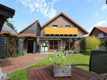Ankerplatz für die ganze Familie - modernes Raumwunder mit Gartenparadies im schönen Rüstersiel