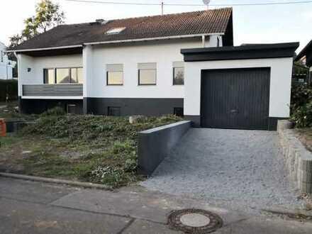 Ein- bis Zweifamilienhaus mit Einliegerwohnung und Einzelgarage