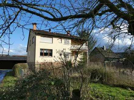 AUMÜLLER-Immobilien - Familienfreundliches 1-2-Familienhaus mit Garage und großem Gartengrundstück