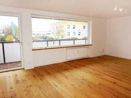 TOP-Sanierte und exklusive 2-Zimmer-Wohnung mit EBK, Balkon und TG in Putzbrunn