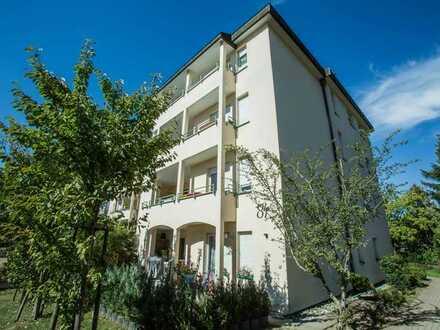 Helle 3,5 Zimmerwohnung Hochpaterre mit Balkon und Gartenzugang