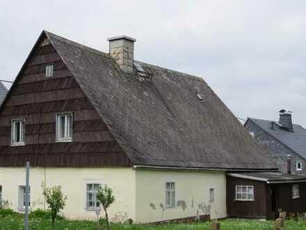 Grundstück mit Ausbauhaus