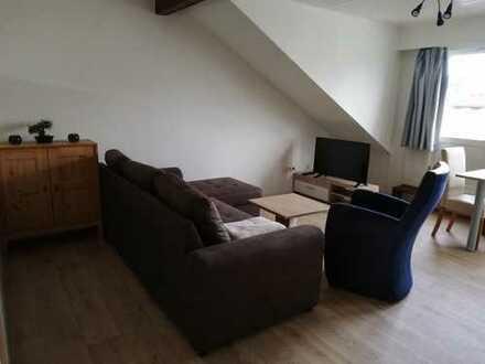 Modernisierte 1-Zimmer-Dachgeschosswohnung mit Balkon und Einbauküche in Bergheim
