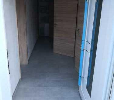 Erstbezug mit Balkon: schöne 3-Zimmer-Erdgeschosswohnung in Udenheim