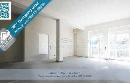 Hohe Decken und moderner Neubauflair mit Aussicht - Exklusive 4 Zimmer Wohnung mit Balkon