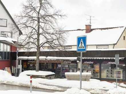 Vermietetes Wohn-/ und Geschäftshaus in zentraler Lage