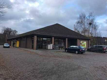 Ebenerdiges Ladenlokal mit Einkaufswagensammelanlage und eigenen Parkplätzen zu vermieten