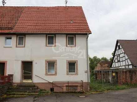 Haus mit weiterem Baugrundstück im Ortskern!