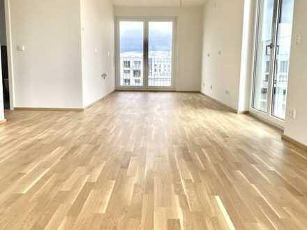 **Erstbezug** 4-Zimmer-Wohnung in oberster Etage mit 2 Balkonen und Einbauküche