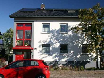 Sandhausen: helle, gepflegte 2 ZKB Souterrain Wohnung mit Wohnküche und Gartenanteil