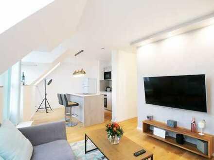 Einzigartige 1,5-Zimmer-DG-Wohnung mit Einbauküche in Lehel, München