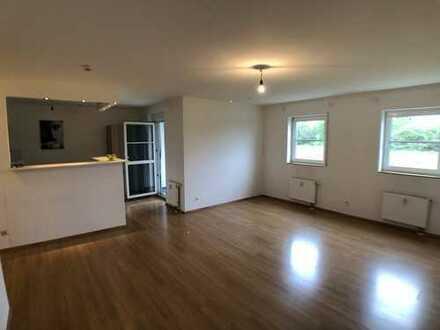 2-Zimmer-Wohnung mit 2 Stellplätzen in TG, EBK, Terrasse und Gartenzugang