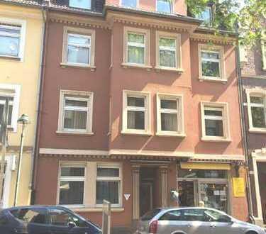 Df.-Benrath: Stilvolles Mehrfamilienhaus mit Ladenlokal
