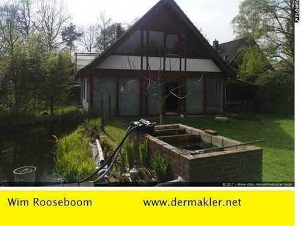 Hude: Traumhaftes Haus mit Einliegerwohnung in TOP-Lage und romantischem Garten