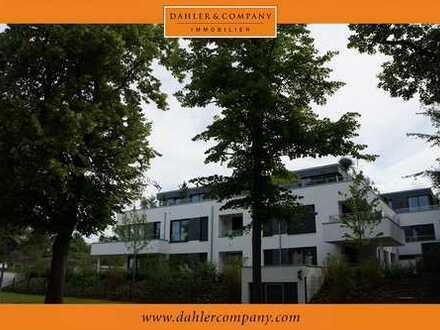 Großzügige Terrassenwohnung mit idyllischem Garten in exklusiver Rheinlage
