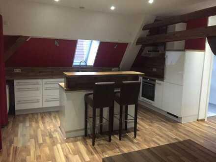 4/5 Zimmer Dachgeschosswohnung mit Einbauküche, Esszimmer und Kaminofen