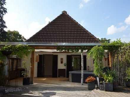 Dachterrassenwohnung mit Hobbyspeicher und Garten