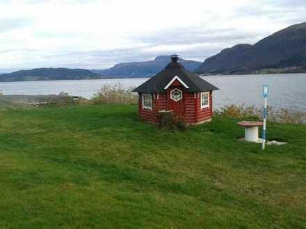 Hübsches Wohnhaus,auch Ferienhaus direkt am Fjord gelegen- Meerblick !!