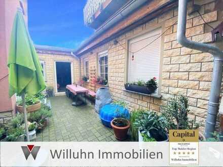 Mehrfamilienhaus & bebaubares Grundstück in bester Lage