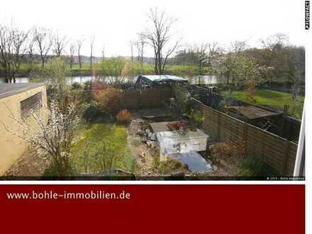 Wohnen in 1. Reihe am Kanal - eigener Garten und Garage!!!!