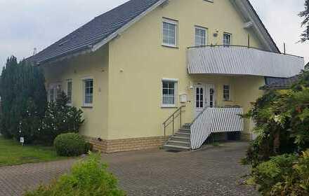 Vermietete Dachgeschosswohnung mit Carport in Gieboldehausen