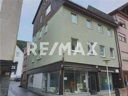 RE/MAX - Ladengeschäft inklusive 2-Zimmerwohnung zu verkaufen.