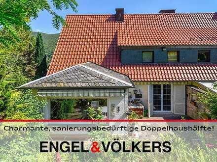 Charmante, sanierungsbedürftige Doppelhaushälfte mit großem Garten in ruhiger Lage von Neustadt!