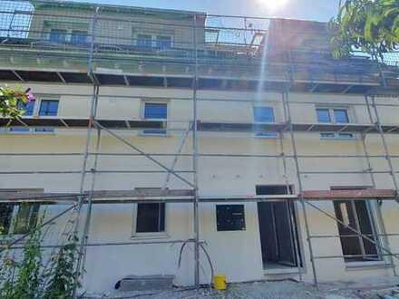 Barrierefreie Neubauwohnung im EG mit Einbauküche zur Vermietung.