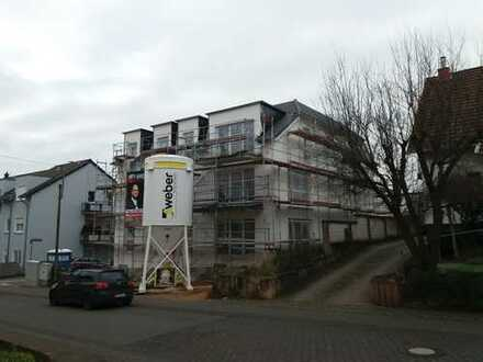 Es handelt sich hier um den Neubau eines Mehrfamilienhauses mit 5 Wohneinheiten und 3 Garagen im Hau