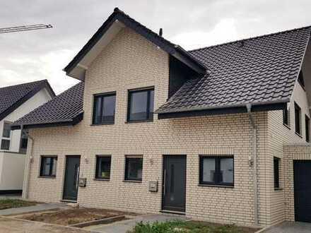 Schöner Wohnen am Tiemannshof: Moderne Neubau-Doppelhaushälfte in bester Lage