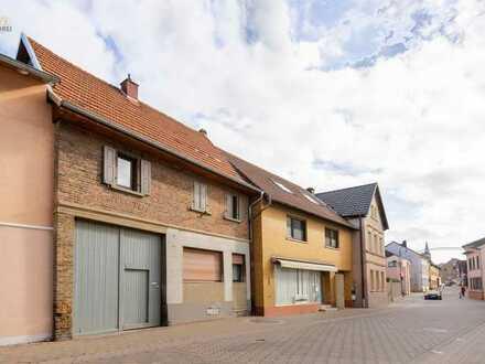 Wohn- und Geschäftshaus zur Eigennutzung + vermietetes Einfamilienhaus zum Kauf in Langenlonsheim